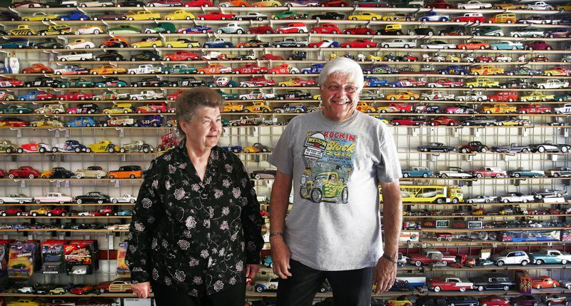 Photo Credit: JIM CLARK - With his wife, Beverly, Farris stands in his garage, which contains scores and scores of model cars.