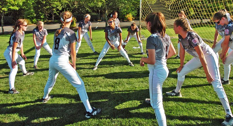 Photo Credit: DAN BROOD - GETTING READY -- Members of the Tigard/Tualatin City Little League softball team start to stretch out prior to a practice last week at Cook Park.