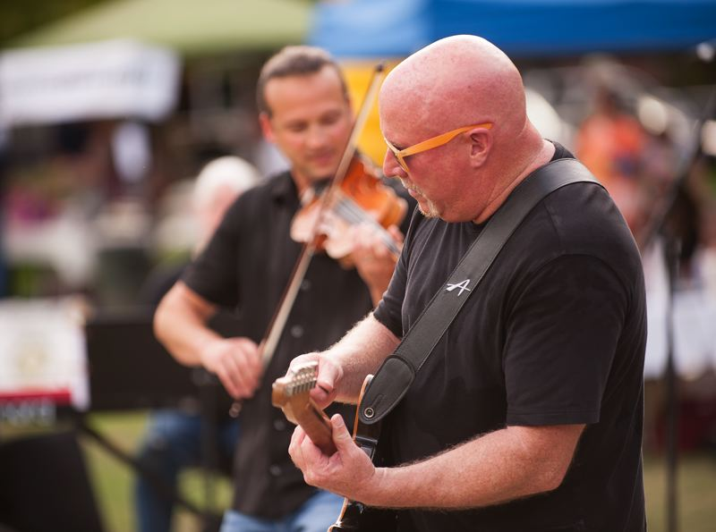 Photo Credit: SPOKESMAN PHOTO: JOSH KULLA - Guitarist Tim Ellis performs with Aaron Meyer at Town Center Park.