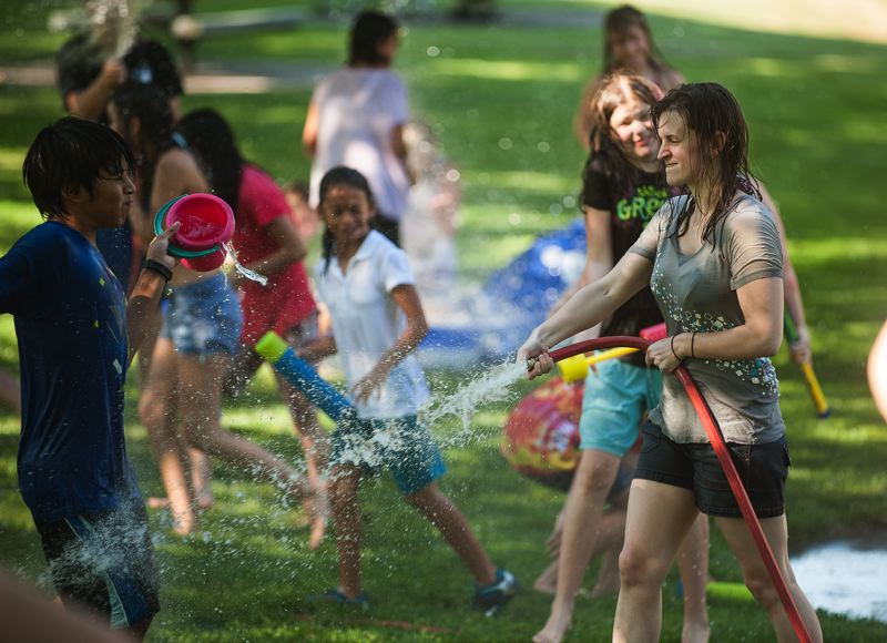 Photo Credit: SPOKESMAN PHOTO: JOSH KULLA - The garden hose is the ultimate weapon in a water fight - you don't have to reload.