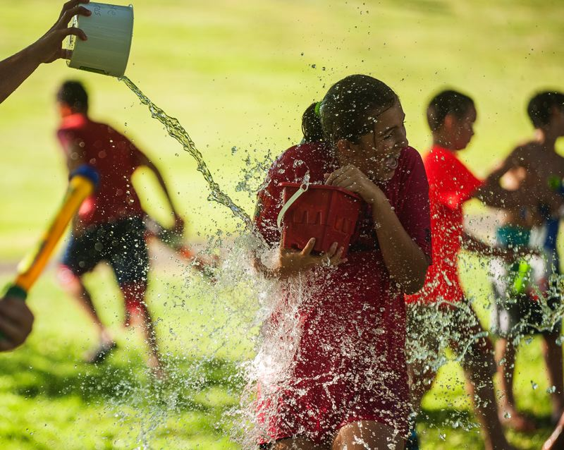 Photo Credit: SPOKESMAN PHOTO: JOSH KULLA - There were no winners - or losers - in the Wilsonville Library's teen water fight July 28.