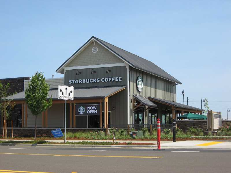 Photo Credit: GAZETTE PHOTO: RAY PITZ - Starbucks officially became the first retailer to open in the new Parkway Village at Sherwood and it didn't take long before residents found out.