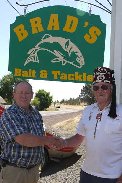 Photo Credit: SUBMITTED PHOTO - Local Shriner Larry Easter, right, congratulates raffle winner Brad Lovrien.