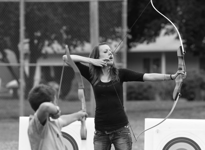 Chelsea LaPoint, an instructor for Archers Afield, demonstrates the proper technique for anchoring a bow during a lesson last week.