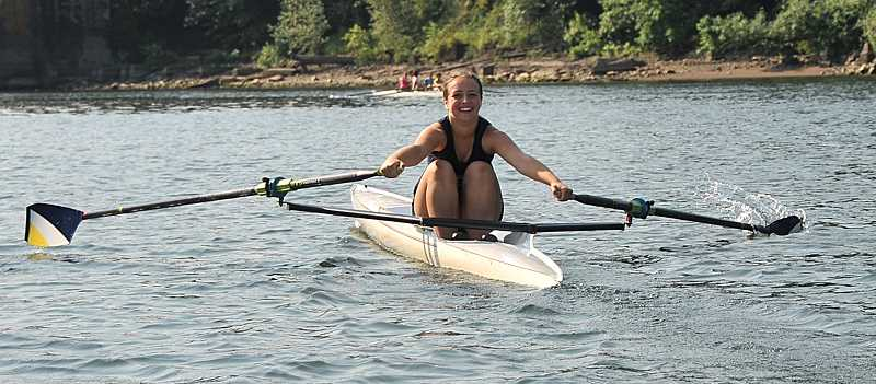 Photo Credit: TIDINGS PHOTO: VERN UYETAKE - Cami Pontarelli shows her form in a single scull.