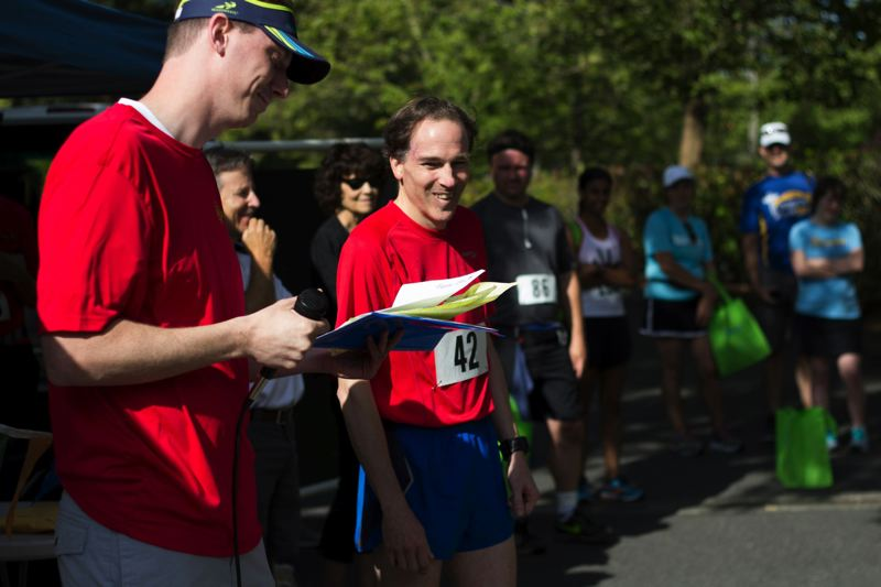 Photo Credit: TIMES PHOTO: LACEY JACOBY - Joe Dudman from Portland takes first place in the 5K during the Sun Run in Beaverton. This year, the run raised about $10,000 for the Beaverton Police Activities League and HomePlate Youth Services.