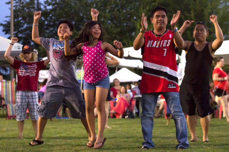 Photo Credit: TIMES PHOTO: LACY JACOBY - People dance late into the evening as The Aphrodisiacs perform at the Tualatin Crawfish Festival.