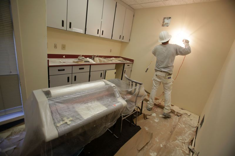 Photo Credit: TIMES PHOTO: JONATHAN HOUSE - Workers continue painting and revamping Valley Catholic's Early Learning Center.