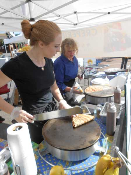 Photo Credit: REVIEW PHOTO: VERN UYETAKE - Former cheerleader Haley Russell is now creating crepes you can cheer for. Her new Le Bon Temps Créperie has been going strong in Lake Oswego this summer.