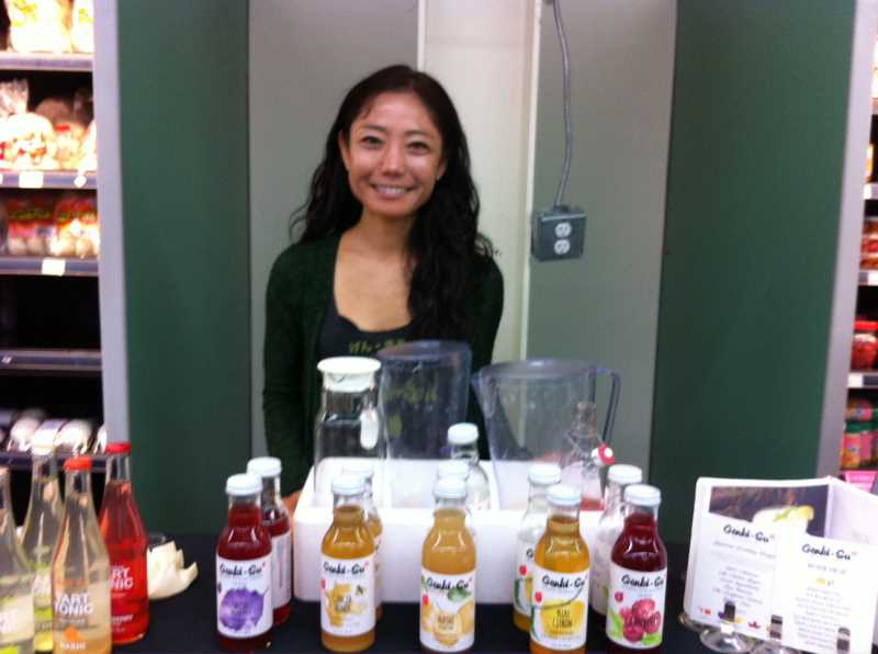 Photo Credit: STAFF PHOTO: BARB RANDALL - Takako Shinjo, co-founder and owner of Genki-Su Japanese drinking vinegars, offers refreshing beverages to cool you during the hot weather.