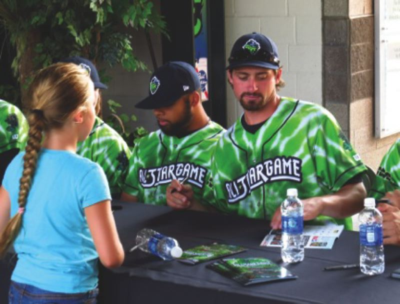 Photo Credit: PAMPLIN MEDIA GROUP: ZACK PALMER - Hillsboro Hops outfielder Jordan Parr (right) and relief pitcher Cody Geyer sign  autographs before Tuesday's Northwest League All-Star Game at PK Park in Eugene.
