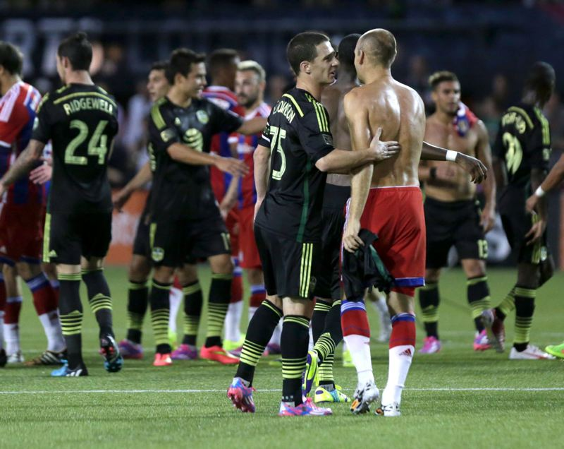 Photo Credit: TRIBUNE PHOTO: JONATHAN HOUSE - Will Johnson of the Portland Timbers talks to Arjen Robben of Bayern Munich after the MLS All-Star game.