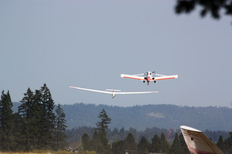 Photo Credit: HILLSBORO TRIBUNE PHOTO: DOUG BURKHARDT - The skies above North Plains were abuzz last weekend with a steady stream of adventurers going up for glider rides. The Willamette Valley Soaring Club operates from the airstrip along Highway 26 just west of North Plains, and business has been brisk.