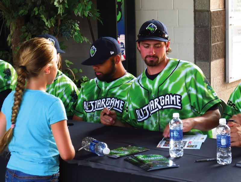 Photo Credit: HILLSBORO TRIBUNE PHOTO: ZACK PALMER - Hillsboro players Jordan Parr (right) and Cody Geyer sign autographs prior to Tuesday's Northwest League all-star game at PK Park.
