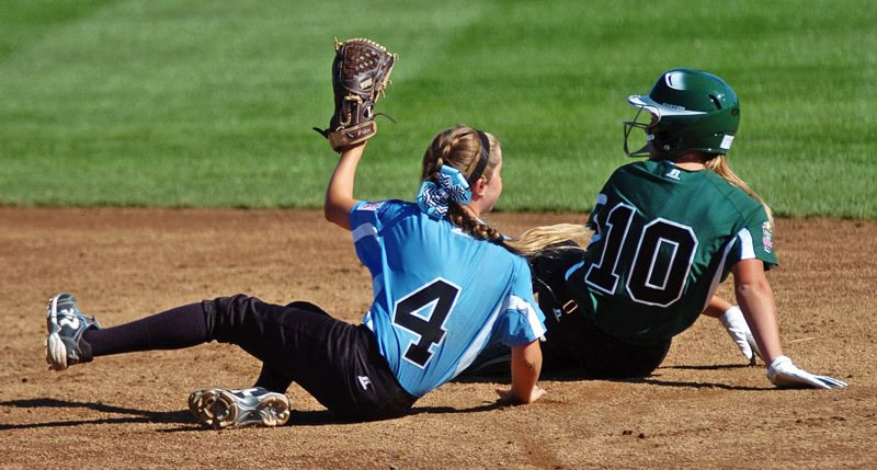 Photo Credit: DAN BROOD - CAUGHT STEALING -- Tigard/Tualatin City shortstop Bella Valdes (left) holds up the ball after tagging out Central's Katelyn Hussing on a stolen-base attempt.