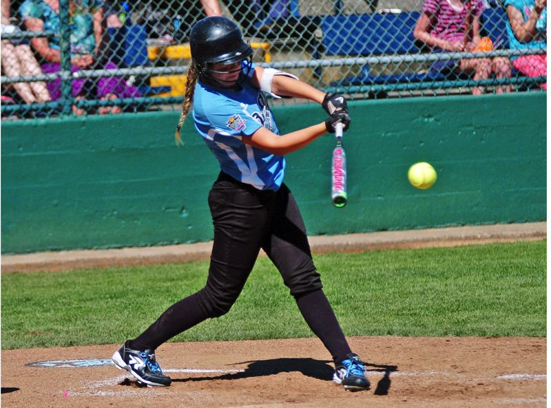 Photo Credit: DAN BROOD - SMACK -- Tigard/Tualatin City's Emily Harms hits a fourth-inning single in Thursday's World Series game.