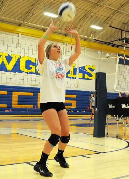 Photo Credit: LON AUSTIN/CENTRAL OREGONIAN - Meghan Wood works on her setting skills during Tuesday morning's session of the Rimrock Vollebyall Camp. Wood will be a sophomore at Crook County High School this year.