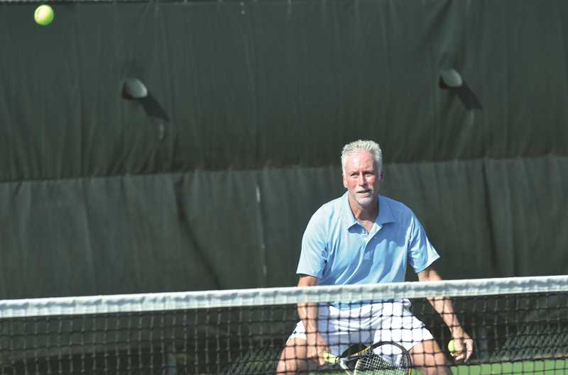 Photo Credit: COREY BUCHANAN - Mike Tammen is the tennis director at The Racquet Club in Portland and is the current world doubles champion in the men's 55 division.