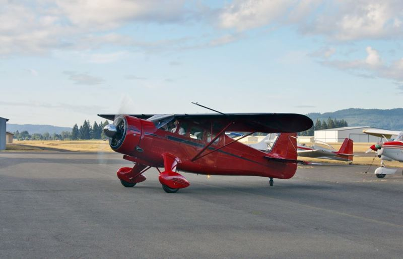 (Image is Clickable Link) Photo Credit: SUBMITTED PHOTO - A 1944 Howard DGA-15P, owned by Tim Weston from Yelm, Washington, was the Grand Champion from last year's fly-in. The fly-in and Highway 30 Cruisers Cruise-In take place Friday, Aug. 15, to Saturday, Aug. 16 at Scappoose airport, and are open to the public.