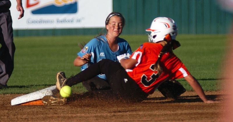 Photo Credit: DAN BROOD - SLIDING HARD -- Georgia's Alyana Taylor (3), in front of Tigard/TC shortstop Bella Valdes, slides hard to second base in the first inning of Friday's World Series game.