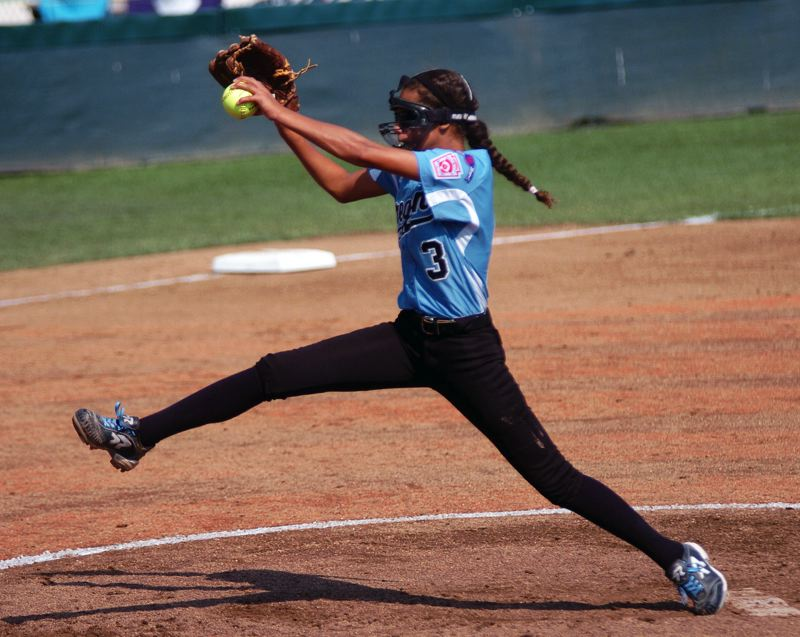 Photo Credit: DAN BROOD - LEFTY, RIGHTY -- Above, Tia Cordts picked up the pitching victory in Tigard/TC's 2-1 win over Puerto Rico on Sunday. Below, Elizabeth Hillier recorded her second straight World Series save on Sunday.