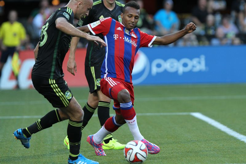 Photo Credit: TRIBUNE PHOTO: JONATHAN HOUSE - Julian Green (right) of Bayern Munich tries to make a move with the ball during the German teams 2-1 loss to the MLS All-Stars at Providence Park.