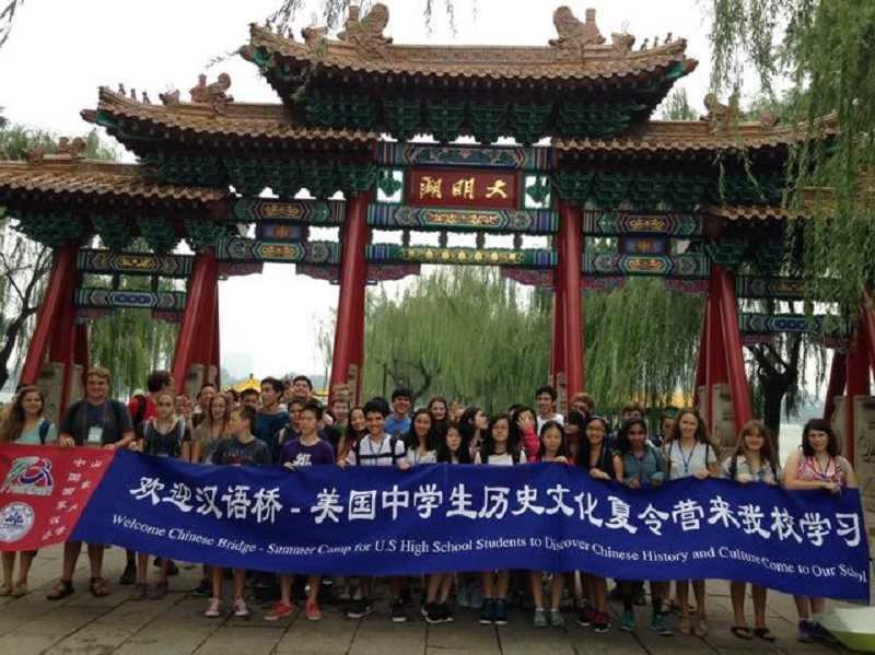 Photo Credit: SUBMITTED PHOTO - Cat Nelson, pictured on the far right, became interested in China and the Chinese language after taking both a language and a culture class as an eighth-grader at Wood Middle School last year. Over the summer, she visited China on via student program offered thought PSU's Confucius Institute, and she plans to continue studying Chinese at Wilsonville High School this school year.