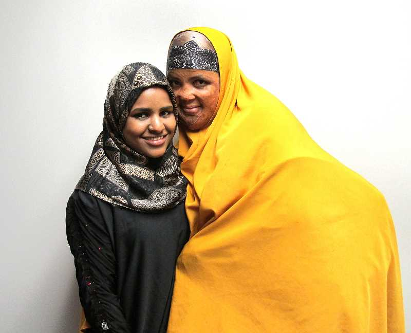 Photo Credit: OUTLOOK PHOTO: LAURA KNUDSON - Because of cultural misconceptions, Amina Abu says the Department of Human Services tried to take her children three times. Abu's 17-year-old daughter is thankful that AYCO stepped in to help.