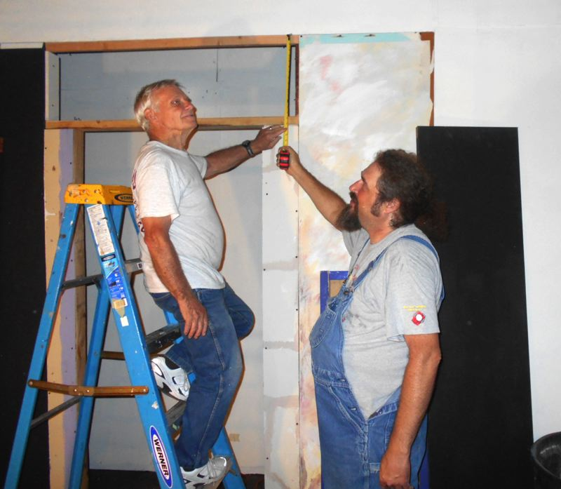 Photo Credit: LEXY DILLON - From left: Sandy Actors Theatre volunteers Richard Keys and Vernon Sonders Jr. work on a set. The popular community theater relies on volunteers like these two to put on its high-quality productions year in and year out.