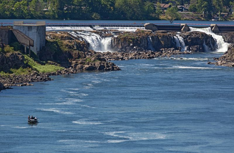 Photo Credit: PAMPLIN MEDIA GROUP: JONATHAN HOUSE - Fishermen stake their claim below Willamette Falls in Oregon City. The Riverwalk project could bring environmental restoration to the falls area and nearby uplands.