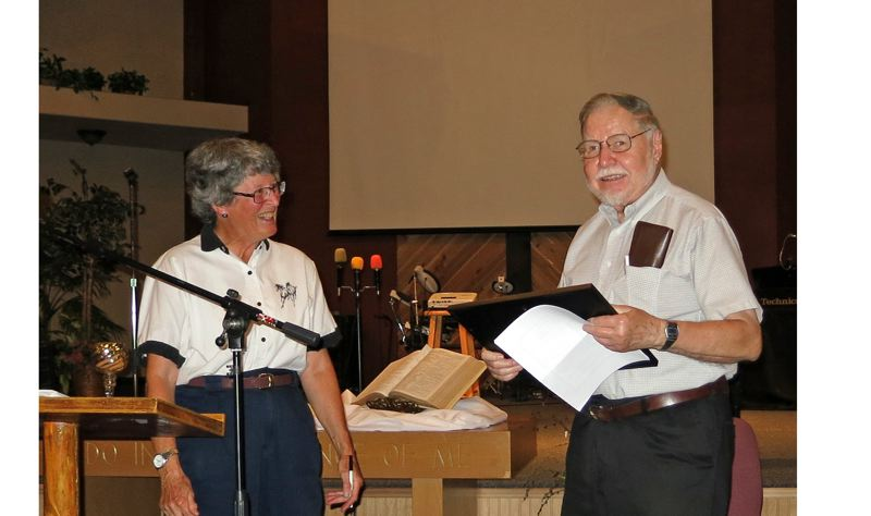 Photo Credit: PHOTO BY STEVE BERLINER - Carol Mastronarde presents Ed Gronke with the Outstanding Citizen Award.