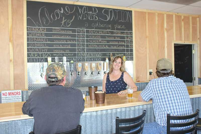 Photo Credit: SUSAN MATHENY/MADRAS PIONEER - Jennifer DuPont can new serve pints at the growler station.