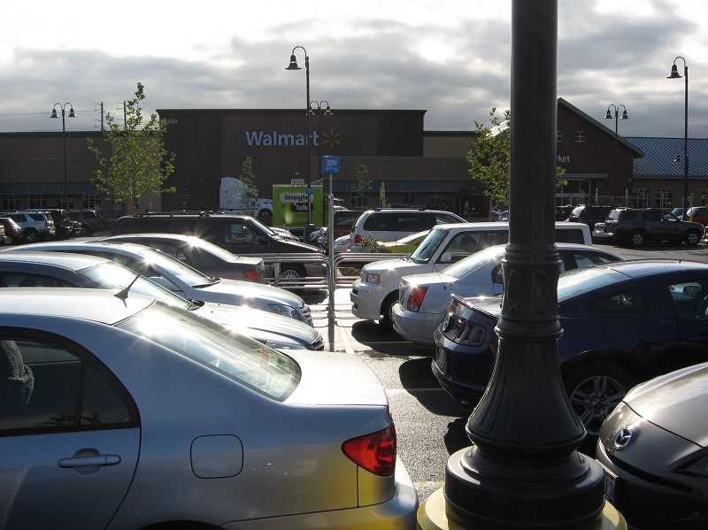 Photo Credit: GAZETTE PHOTO: RAY PITZ - The parking lot of the new Sherwood Walmart was completely jammed all morning long and cars continued streaming through the lot all day Wednesday.