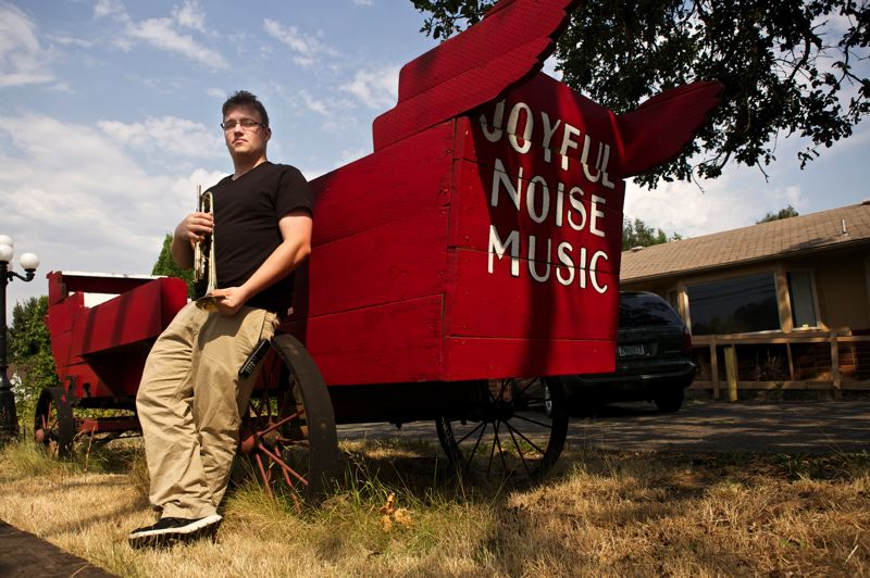 Photo Credit: TIMES PHOTO: JAIME VALDEZ - Jake Schmidt holds a trumpet, one of 35 instruments collected by the Beaverton Education Foundation's Band Together initiative. The instruments are being stored at the Joyful Noise of Music in Clackamas.