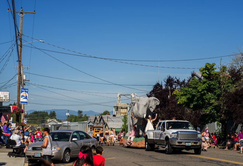 Photo Credit: HILLSBORO TRIBUNE PHOTO: CHASE ALLGOOD - The George Morland Plumbing float in the Saturday parade through downtown North Plains featured a large elephant figure -- symbolizing elephant garlic -- as well as the king and queen of the 17th annual festival.