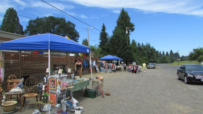 Photo Credit: MARK MILLER - A sleepy Friday at the Florence Park Outdoor Market south of Scappoose. Dealers at the flea market sell a variety of wares. Market manager Ken Page says it has built up a small but loyal customer base as of its second year in operation.
