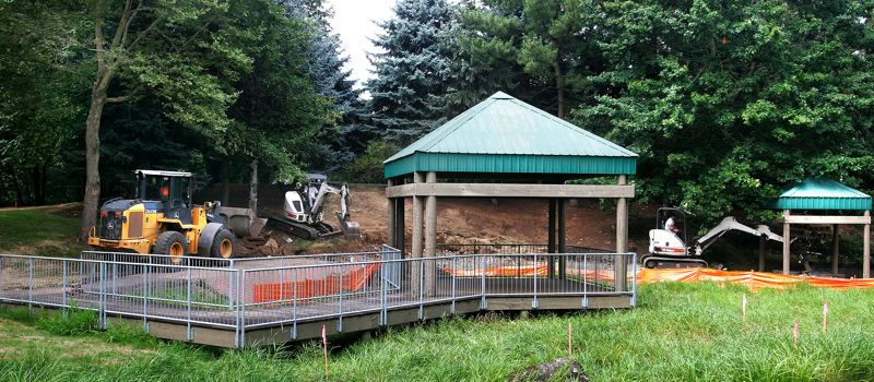 Photo Credit: OUTLOOK PHOTO: JIM CLARK - A front end loader tears up an old portion of Park Cleone to make way for a couple of ponds.
