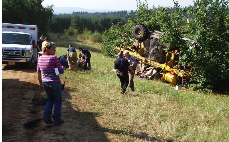 Photo Credit: CONTRIBUTED PHOTO: CLACKAMAS COUNTY SHERIFFS OFFICE - Emergency personnel responded to this scene of a berry harvster the flipped over Monday morning near Sandy, injuring six workers that were on the machine.