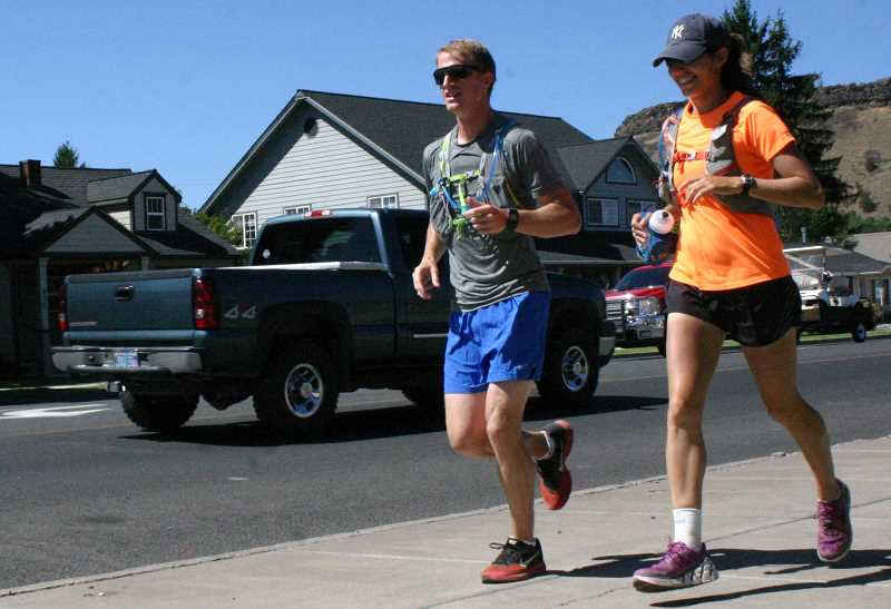 Photo Credit: JASON CHANEY - Adam Meyer and Ashley Donovan arrived in Prineville on Friday, Aug. 8. They will conclude their cross-country trek in Washington, D.C.