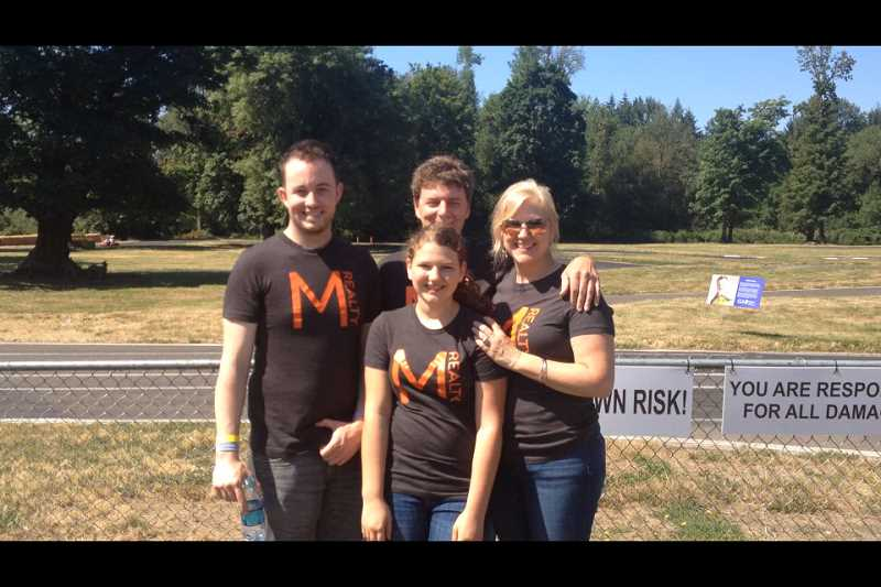 Photo Credit: SUBMITTED PHOTO - Guild Mortgage recently sponsored a Can-Am Charity Karting event, which was presented by M Realty. Pictured from left are M Realty employee Jeff Brooks, owners Garron and Alicia Selliken, and front, the Sellikens daughter, Emma.