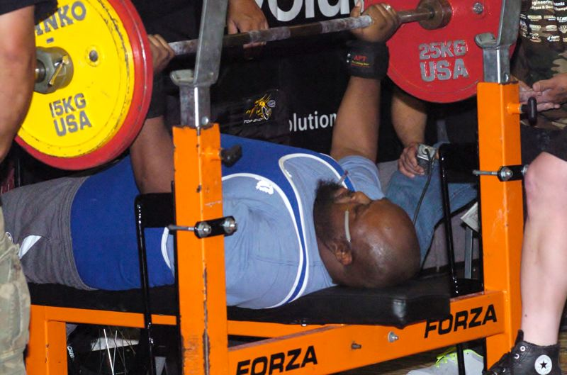Photo Credit: CONTRIBUTED PHOTO - J.C. Smith sets a new record in the bench press in his category.