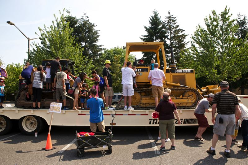 Photo Credit: TIMES PHOTO: JAIME VALDEZ - Children climb on heavy machinery at the 16th annual Big Truck Day event at the Conestoga Recreation and Aquatic Center.