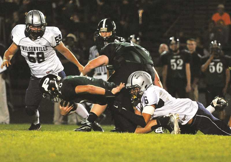 Photo Credit: SPOKESMAN FILE PHOTO - Sione Kauhi drags a Parkrose player to the ground while playing defensive end for the Wildcats two years ago.