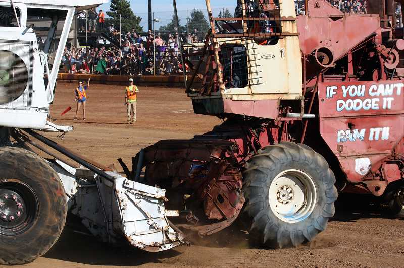 Two combines hit head-on during the demo derby, with the force of the impact propelling the rear ends of both machines into the air.