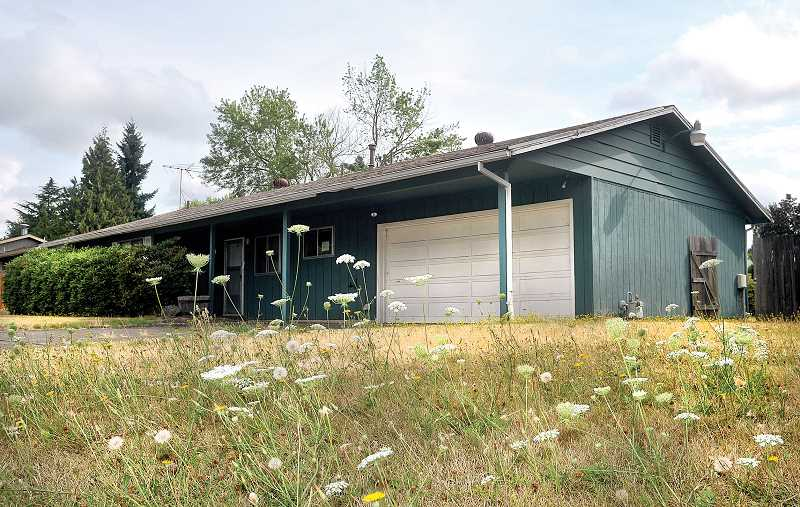 Photo Credit: GARY ALLEN - Grim reminder - The family home of Randall and Amy Engels will be auctioned off at a Sheriff's Sale Sept. 15 in McMinnville. The property was the site of a murder-suicide July 4, 2012.