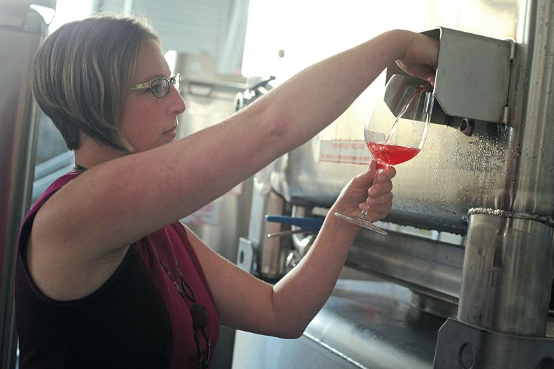 Photo Credit: TRIBUNE PHOTO: JONATHAN HOUSE - Southeast Portland winemaker Anne Hubatch pours a sample of her first batch of Alter Ego cider made at Coopers Hall this summer. Anyone with a winery license in Oregon can make cider; breweries, too, are also getting in on the action as the market grows.