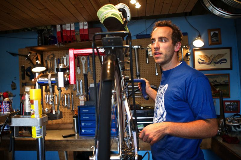 Photo Credit: TRIBUNE PHOTO: JAIME VALDEZ - Abraham Sutfin, owner of Abraham Fixes Bikes at North Williams and Fremont Street, prefers quieter neighborhood streets to the crowds of cyclists on Williams.
