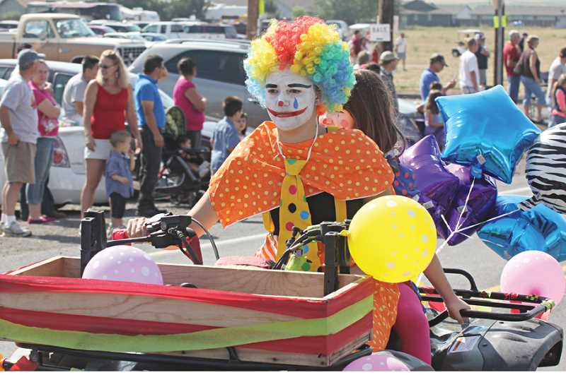 Photo Credit: JEFF WILSON - Culver students Samantha Symons, driving a four-wheeler, and Olivia O'Rourke were among 317 participants in the largest Culver parade ever at the Culver Crawdad Festival Saturday.
