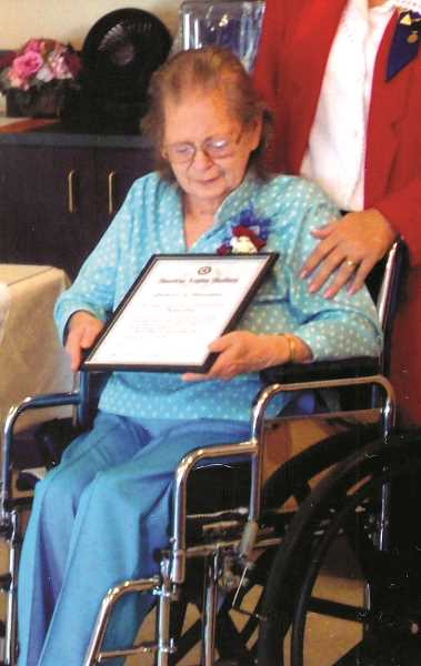 Photo Credit: SUBMITTED PHOTO - Thelma Cook receives an award from American Legion Post 122 for her longtime efforts to help veterans by making slippers - 2,875 pairs of them - from 1998 to the present.