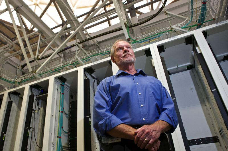 Photo Credit: TIMES PHOTO: JAIME VALDEZ - Perry Gliessman stands in a pod where racks of servers are cooled inside OHSU's new Data Center West in Aloha.